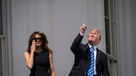 U.S. President Donald Trump, at the White House, spots the eclipse (Jabin Botsford/The Washington Post/Getty Images)
