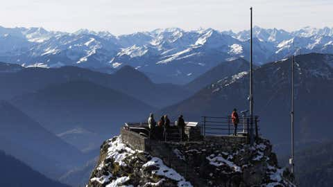 Hikers enjoy the view over the Alps from a viewing platform near the top of Wendelstein mountain (6,030 feet) near Bayrischzell, southern Germany, on Wednesday, Oct. 17. (AP Photo/Matthias Schrader)