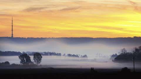 Stripes of land are blanketed by fog under a television tower during sunrise in Ujudvar near Budapest, Hungary, on Oct. 20, when the weather was sunny and unusually warm in most parts of the country. (AP Photo/MTI, Gyorgy Varga)