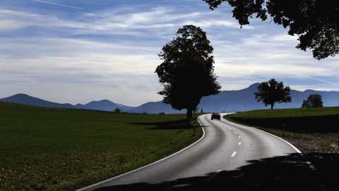 A car drives on a sunny autumn day near Weilheim, Germany, Thursday, on Oct. 18. (AP Photo/Matthias Schrader)