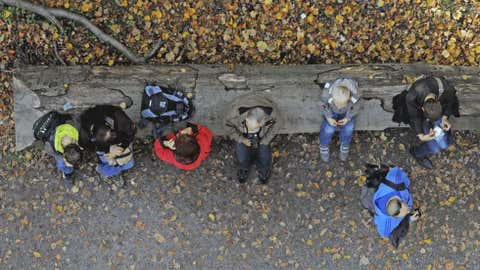 Hikers have a break in the National Park Hainich near Bad Langensalza, central Germany, on Oct. 21. Weather forecasts predicted good autumnal weather conditions in Germany for the upcoming days. (AP Photo/Jens Meyer)