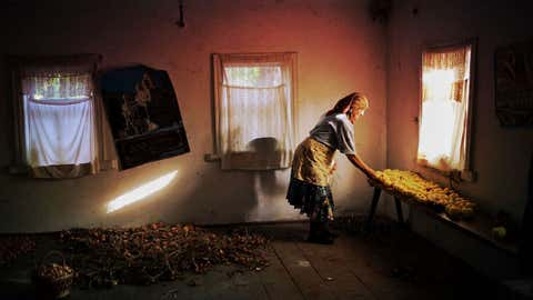 """A woman evacuated from a town near the site of the 1986 Chernobyl nuclear accident returns to her former home in Alina Rudya's photography project """"Prypyat Mon Amour."""""""