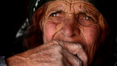 An elderly woman from the Qashqai tribe sits inside a tent in Eghlid in the southern Iranian province of Fars on July 8, 2008. Little has changed for the modern-day descendants of those who lived 2,500 years ago in what is now Iran. (ATTA KENARE/AFP/Getty Images)