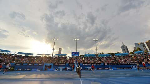 Spectators watch the match between Canada's Eugenie Bouchard and France's Virginie Razzano during their second-round women's singles match on Day 3 of the 2014 Australian Open tennis tournament in Melbourne on January 15, 2014. (SAEED KHAN/AFP/Getty Images)
