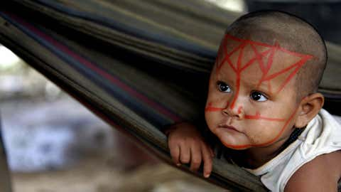 An indigenous girl belonging to the Nukak-Maku ethnic group, the last nomadic people of Colombia, lays in a hammock on April 7, 2008, in a provisional settlement in Barrancon Bajo near San Jose del Guaviare. (RODRIGO ARANGUA/AFP/Getty Images)