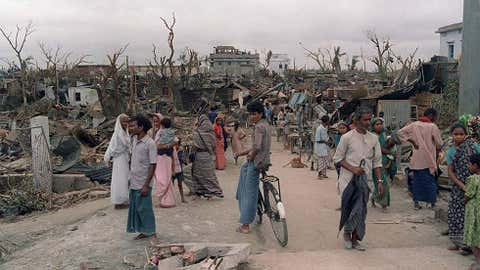 Bangladeshi men, women and children walk in the ruins of their city on April 30, 1989, in Saturia, as the houses were reduced to scraps during a severe tornado on April 26. Image credit: David L. Nelson/AFP/Getty Images