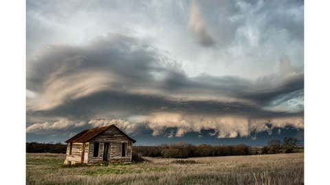 """""""Eastern Oklahoma Countryside"""": A severe thunderstorm approaches an old abandoned prairie house in eastern Oklahoma in late March of this year. (Submitted by Marcus Hustedde)"""