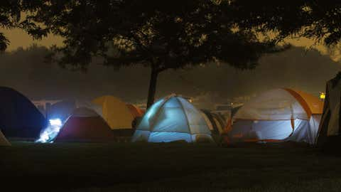 Under a fog of heavy smoke, fire crews get ready for a night of sleep Thursday, Sept. 13, 2012, at Confluence State Park in Wenatchee, Wash., where a camp has been set up to house and feed personell here to fight fires in North Central Washington.