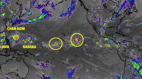 Pacific Ocean satellite image showing three western Pacific tropical cyclones and two disturbances in the central Pacific on July 7, 2015 at 1415 UTC. (NASA/MSFC/JMA)