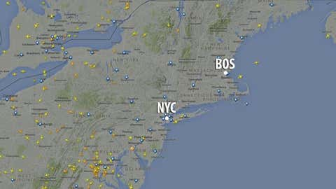 Screen grab of active flights (denoted by yellow or orange plane symbols) over the Northeast U.S. on Jan. 27, 2015 at 11:20 a.m. EST. Boston and New York City metro areas are labeled.