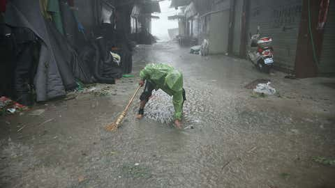 A man dredges a sewer after Typhoon Soudelor brought heavy rain to Ningde, in eastern China's Fujian province.  (STR/AFP/Getty Images)
