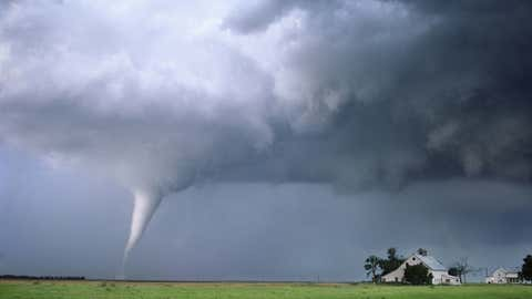 A strong tornado approaches a farmstead in Nebraska on June 9th, 2003. This storm resulted in the destruction of several farms similar to this one.
