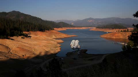 Houseboats are dwarfed by the steep banks of Shasta Lake at Bridge Bay Resort on Aug. 31, 2014 in Redding, California. (Justin Sullivan/Getty Images)