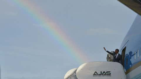 A rainbow appears in the sky as President Barack Obama waves from the Air Force One in Kingston, Jamaica, on April 9, 2015.