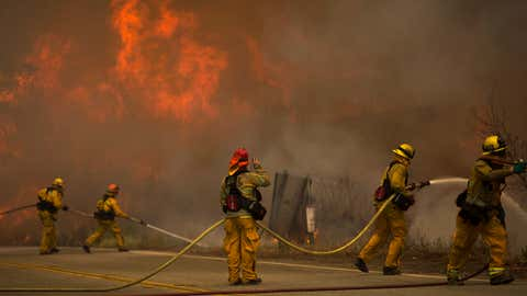 Firefighters battle flames in Placerita Canyon at the Sand Fire on July 24, 2016 in Santa Clarita, Calif. (Photo by David McNew/Getty Images)