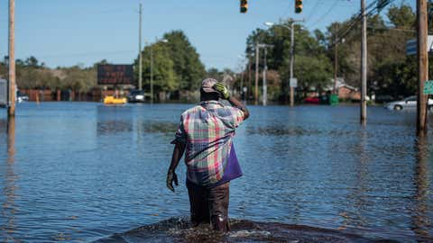 Chris Moore walks down Martin Luther King Blvd. on October 12, 2016 in Lumberton, North Carolina. Hurricane Matthew's heavy rains ended over the weekend, but flooding is still expected for days in North Carolina. (Sean Rayford/Getty Images)