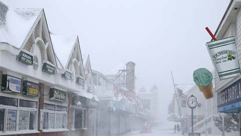 People walk on the boardwalk on January 7, 2017 in Ocean City, Maryland. It's estimated that Winter Storm Helena dumped more than eight inches of snow in the lower Eastern Shore of Maryland as Ocean City was under a Winter Storm Warning. (Photo by Patrick Smith/Getty Images)