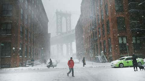 Pedestrians walk in the snow and wind on February 9, 2017 in the Brooklyn borough of New York City. A major winter storm warning is forecast from Pennsylvania to Maine with the New York City area expected to receive up to one foot of snow. New York City schools are closed for the day.  (Spencer Platt/Getty Images)