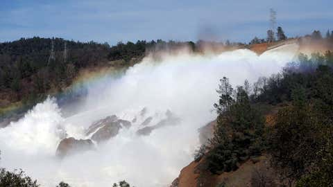 The Oroville Dam spillway overflows with runoff in Oroville, California on February 14, 2017. A sheriff  lifted a mandatory evacuation order in northern California, which had impacted nearly 200,000 people in an area under threat of catastrophic failure at the tallest dam in the United States. (Monica Davey/AFP/Getty Images)