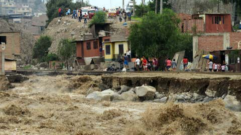 View of sections of the central railroad track that follows the Rimac River, which suffered severe damage by rising water and flash foods in the town of Chosica, at the foot of the Andes mountains east of Lima, on March 18, 2017. (CRIS BOURONCLE/AFP/Getty Images)