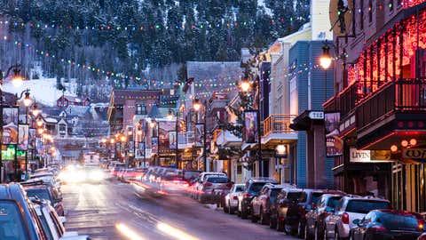Long exposure of cars driving down Main St. in Park City, Utah.