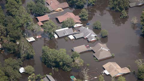 Homes are surrounded by floodwater after torrential rains pounded Southeast Texas following Hurricane and Tropical Storm Harvey on August 31, 2017 in Orange, Texas. Harvey, which made landfall north of Corpus Christi August 25, has dumped nearly 50 inches of rain in and around areas Houston.  (Scott Olson/Getty Images)