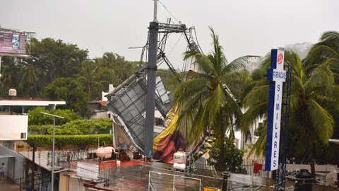 A billboard knocked down by strong winds is seen before the arrival of Hurricane Max in Puerto Marquez, Mexico, on Sept. 14, 2017. (FRANCISCO ROBLES/AFP/Getty Images)