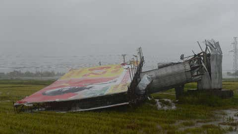 A large billboard lies on the ground, damaged from strong winds, in the central province of Ha Tinh as Typhoon Doksuri makes landfall on the country's central coast on Sept. 15, 2017. (HOANG DINH NAM/AFP/Getty Images)