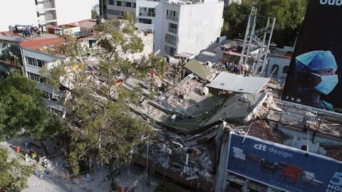 View of buildings flattened by a powerful quake in Mexico City on September 19, 2017. A devastating quake in Mexico on Tuesday killed more than 240 people, according to official tallies, with a preliminary 30 deaths recorded in the capital where rescue efforts were still going on. (Mario Vazquez/AFP/Getty Images)