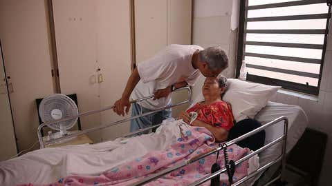 Rafael Robles-Ortiz kisses his mother Josefina Ortiz who is staying at the Hermanitas de los Ancianos Desamparados facility which cares for the elderly as they deal with the aftermath of Hurricane Maria on September 26, 2017 in San Juan, Puerto Rico. Mr. Robles-Ortiz is concerned for his mother and hopes aid -- including fuel for the facilities generators, as well as food and medicine for his mother -- gets through after Hurricane Maria, a category 4 hurricane, devastated the island.  (Joe Raedle/Getty Images)
