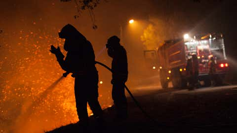 Firefighters battle a forest wildfire next to Vilarinho village, near Lousa, on Oct. 16, 2017 in Coimbra region, Portugal. (Pablo Blazquez Dominguez/Getty Images)