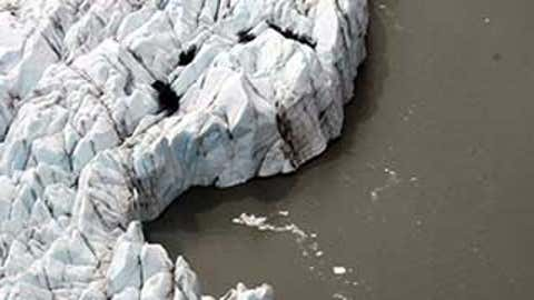 The search area, which covers about 3 acres, is near the toe of the glacier, and the leading edge is constantly being cleaved off and pushed into the lake. (AP)