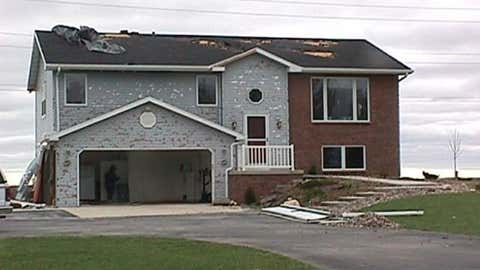 A home near Calumet, Wisconsin suffered hail damage on May 12, 2000.