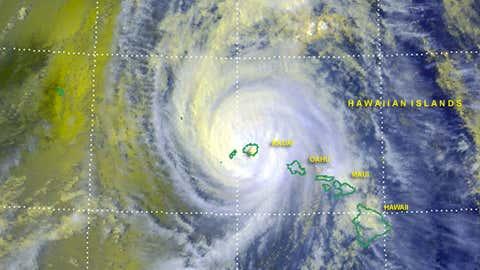 Satellite imagery showing Hurricane Iniki making landfall.