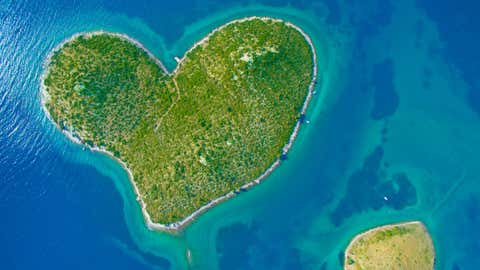 View of Heart Island, Galesnjak, Croatia. The privately-owned island is one of the world's few naturally occurring heart-shaped objects. (paulprescott72/Thinkstock)