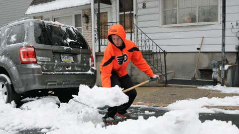 Eric Heck, shows proper form as he bends at the knees shoveling snow on S. 19th Street, Wednesday, Jan. 16, 2013 in Pottsville, Pa.