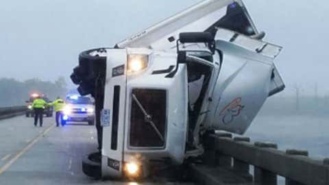 A man was killed Saturday after his tractor-trailer overturned because of high winds on the Lindsay C. Warren Bridge east of Columbia, North Carolina.