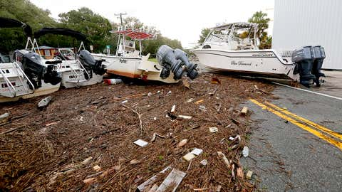 Debris and boats are scattered across the road in Steinhatchee, Florida after Hurricane Hermine tore through the area on Friday, Sept. 2, 2016. Hermine was downgraded to a tropical storm after it made landfall, as it moves over Georgia. (Matt Stamey/The Gainesville Sun via AP)