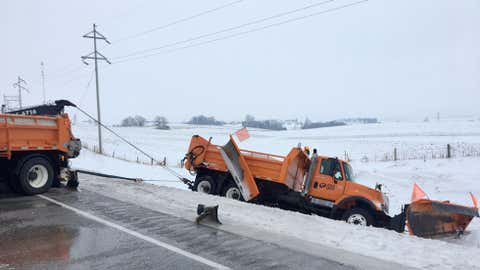 An Iowa Department of Transportation snow plow slid off the road Monday morning. (Twitter/Iowa State Trooper Jon Stickney)