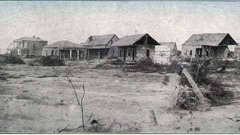 An image of homes damaged in the 1886 Indianola hurricane.