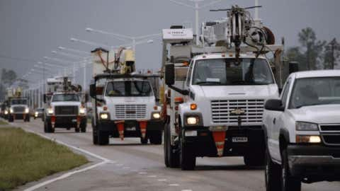 A steady armada of utility service trucks drive through Waveland, Miss., to assist residents left without power from Hurricane Isaac, Thursday, Aug. 30, 2012. Signs of life returned to the Mississippi Gulf Coast on Thursday as curfews were lifted and some businesses and roads reopened.