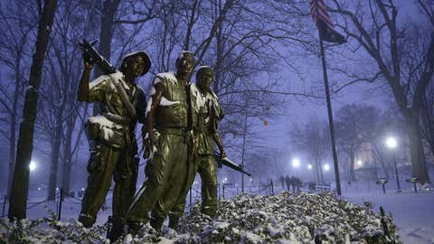 The Three Soldiers statue near the Vietnam War Memorial is under snowfall on January 22, 2016 in Washington, DC. The Washington region is under a blizzard with a forecast of up to 30 inches, 76 cm of snow. (MANDEL NGAN/AFP/Getty Images)
