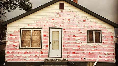 Siding was damaged and windows were blown out in a hailstorm on July 10, 2016, in Killdeer, North Dakota. (Chris Sand/Instagram)