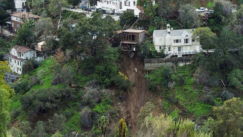 A home sits on the edge of a cliff January 13, 2017 in the Hollywood Hills after it's concrete patio was washed away in a mudslide caused by heavy rains in Hollywood, California. (ROBYN BECK/AFP/Getty Images)