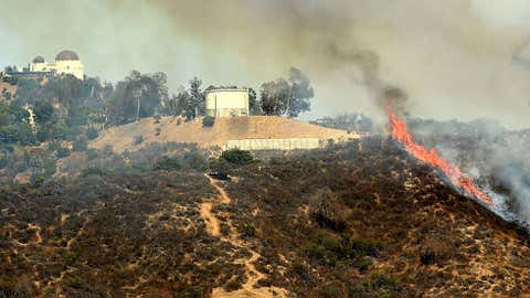 A wildfire burns in the Hollywood hills on July 19, 2016 in Los Angeles, California. (Kevin Winter/Getty Images)