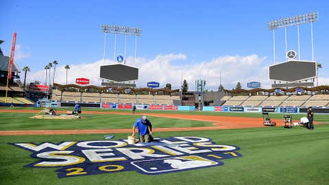 The World Series logo is painted on to the field in preparation for game one and two at Dodger Stadium on October 20, 2017 in Los Angeles, California. (Harry How/Getty Images)