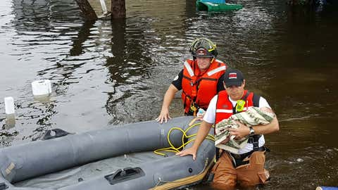 Emrgency responders in Largo rescue a baby from Tropical Storm Colin floodwaters Tuesday. (Largo Police Department)