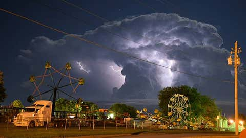 Lightning flashes from a thunderstorm near the fairgrounds in Le Mars, Iowa, on August 2, 2015.