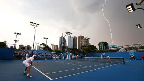 Lightning strikes over Melbourne Park during the first round doubles match between Rameez Junaid of Australia and Adrian Mannarino of France, and Rohan Bopanna of India and Aisam-Ul-Haq Qureshi of Pakistan during day four of the 2014 Australian Open at Melbourne Park on January 16, 2014 in Melbourne, Australia. (Robert Prezioso/Getty Images)