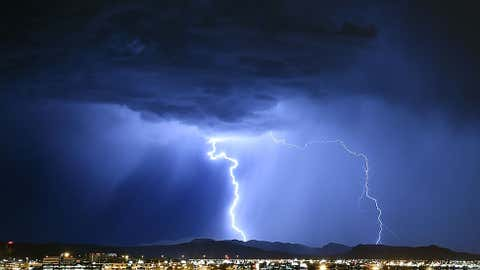 Lightning strikes during a thunderstorm on July 6, 2015 in Las Vegas, Nevada. The monsoon storm dropped heavy rain and hail in parts of the valley causing street flooding and power outages. (Photo by Ethan Miller/Getty Images)